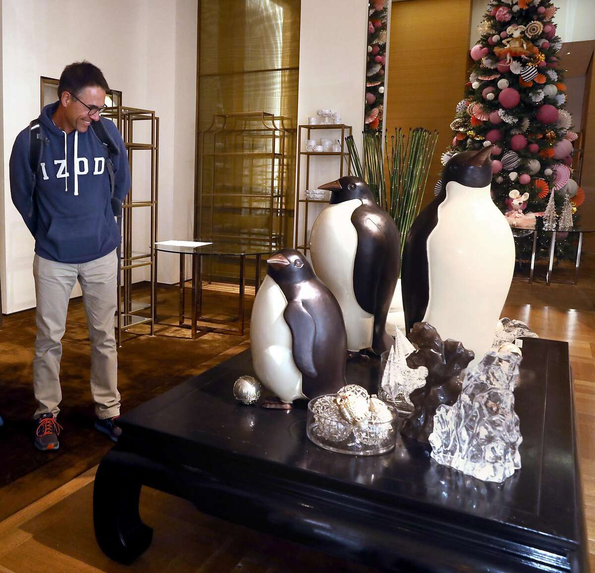 Andreas Huttmann visiting from Germany admires the penguin artwork from Robert Kuo seen at Gump�s which is opening a store in time for the holiday season seen on Post St. near Union Square on Thursday, Oct. 3, 2019, in San Francisco, Calif.