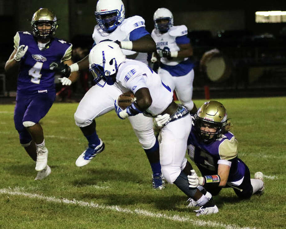 CM's Dillon Dublo (right) takes down Cahokia running back Vincent Perry while the Eagles' Alex Reams (4) pursues the play Sept. 13 in Bethalto. CM, whose lone defeat in a 4-1 start came to the Comanches, are back at home Friday for a key Mississippi Valley Conference game against Highland. Photo: Greg Shashack / The Telegraph