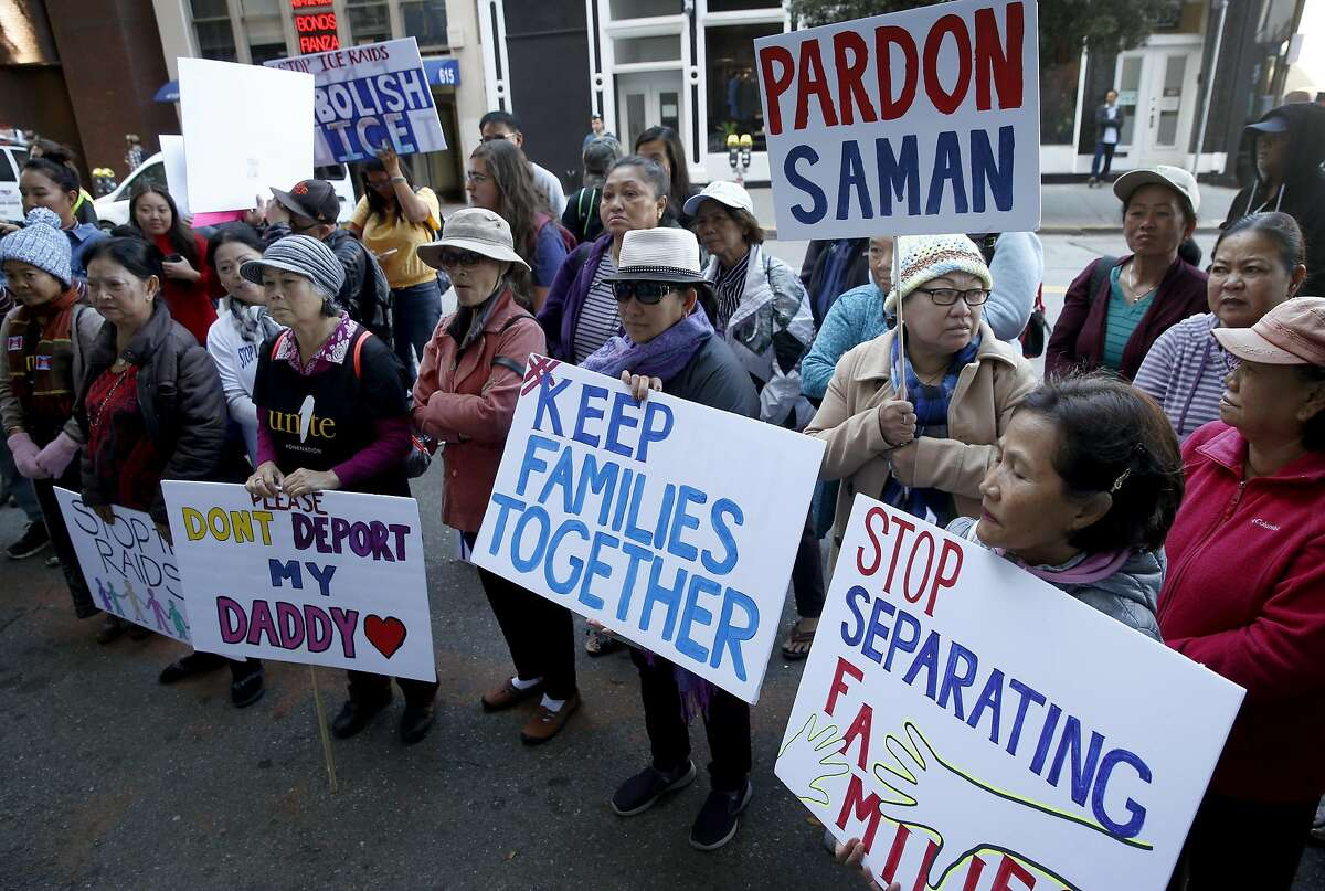 Demonstrators gather in front of Immigration and Customs Enforcement offices on Sansome Street in San Francisco, Calif. on Thursday, Oct. 3, 2019 to protest a sixth round of immigration raids targeting Cambodian refugees.
