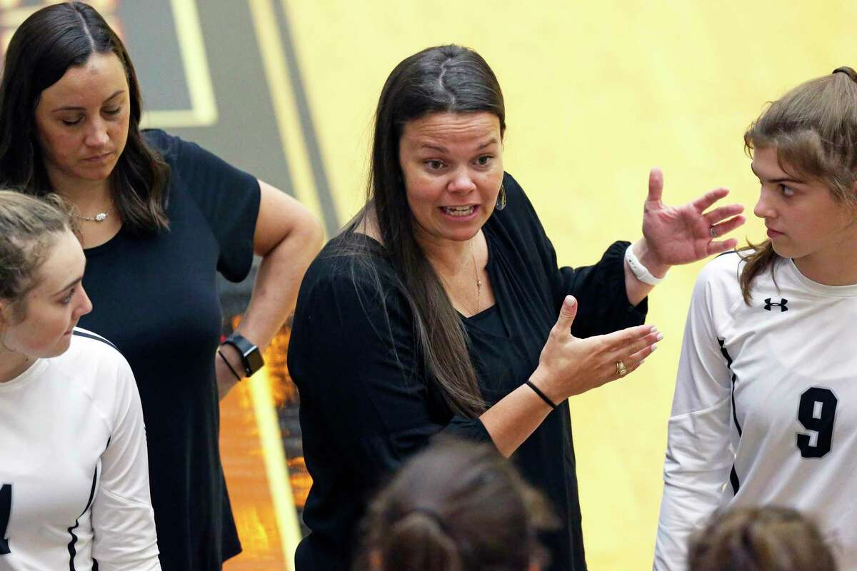 Cougar coach Melissa Miller gives instructions as Reagan hosts Clark in volleyball at Littleton Gym on August 13, 2019.