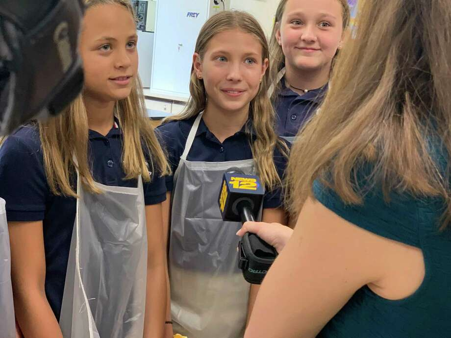 Holy Trinity Catholic Academy students, left to right, Isabella Dejesus, Maya Rafalko and Abby Kudravy speak to reporter Lena Salzbank. Photo: Contributed Photo / / Connecticut Post