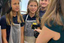 Holy Trinity Catholic Academy students, left to right, Isabella Dejesus, Maya Rafalko and Abby Kudravy speak to reporter Lena Salzbank.