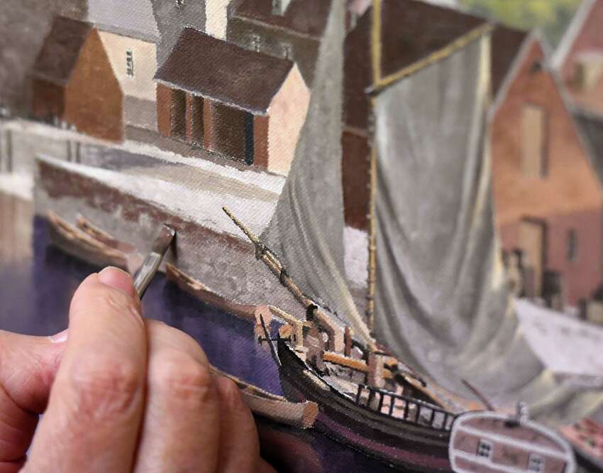 Artist Len Tantillo works on a painting of Quebec from1685 on Wednesday, Sept. 4, 2019, at his studio in Nassau, N.Y. (Will Waldron/Times Union)