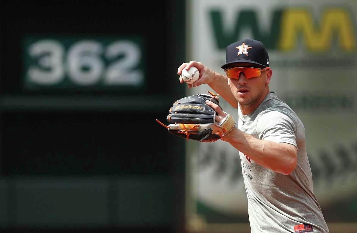 Houston Astros Alex Bregman throws the ball during drills at batting practice as the Astros prepare for Game 1 of an MLB baseball ALDS playoff game at Minute Maid Park Thursday, Oct. 3, 2019, in Houston .