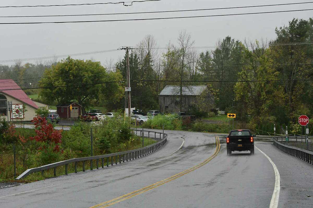 From Rt. 30, the Apple Barrel Country Store is seen on the left of the new memorial for the limousine crash victims on Thursday, Oct. 3, 2019 in Schoharie, N.Y. (Lori Van Buren/Times Union)