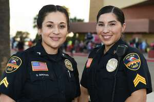 Law enforcement officers interact with Laredoans, Tuesday, Oct. 1, 2019, at the Sames Auto Arena parking lot during National Night Out.