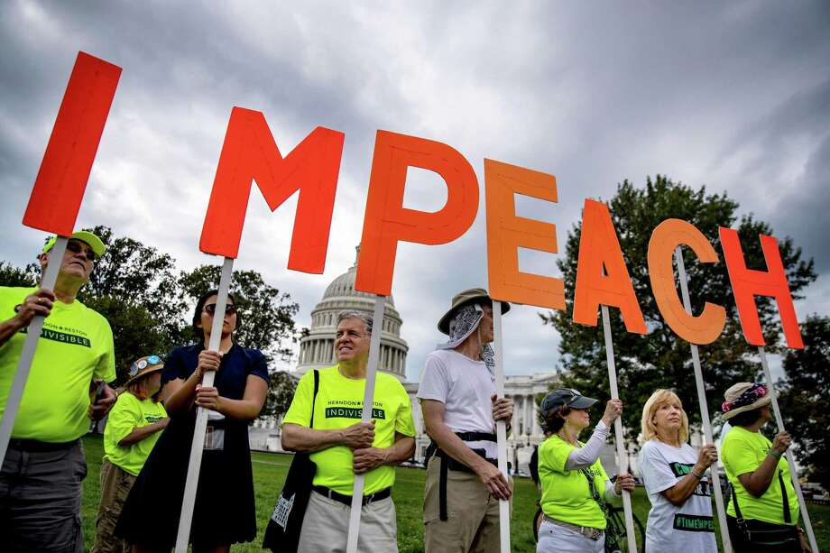 Protesters in Washington back action against President Donald Trump. A reader says the vote offers a better chance of removing him. Photo: ANNA MONEYMAKER / NYT / NYTNS
