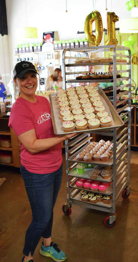 The Cup owner and founder, Ericka Frank, shows off a tray of confetti cupcakes. Photo: Tyler Pletsch | The Intelligencer