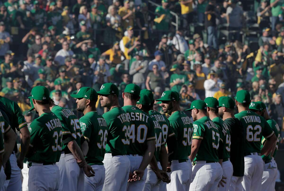 A's players in formation for introductions before the Oakland Athletics played the Tampa Bay Rays at the Oakland Coliseum in the AL Wild Card playoff game in Oakland, Calif., on Wednesday, October 2, 2019.