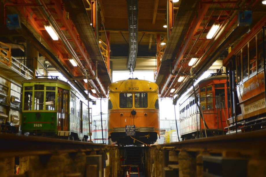 Streetcars from all around the world and from several different eras of public transit are maintained at the Cameron Beach Yard, which is closed to the public. These streetcars sit in the garage of the facility, where streetcars undergo maintenance. Photo: Drew Costley/SFGate