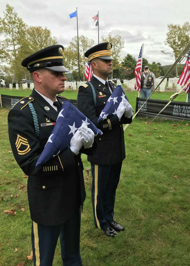 The Connecticut Department of Veterans Affairs and Connecticut Funeral Directors Association held a military funeral ceremony for four U.S. veterans' unclaimed cremated remains, who include veterans of the Spanish-American War, World War I and World War II. Photo: Jeff Mill / Hearst Connecticut Media