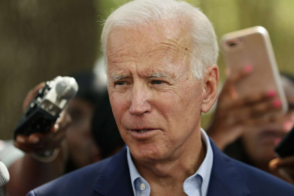 Democratic presidential candidate Joe Biden speaks to members of the media following a visit with students on the campus of Texas Southern University on Sept. 13, 2019, in Houston.