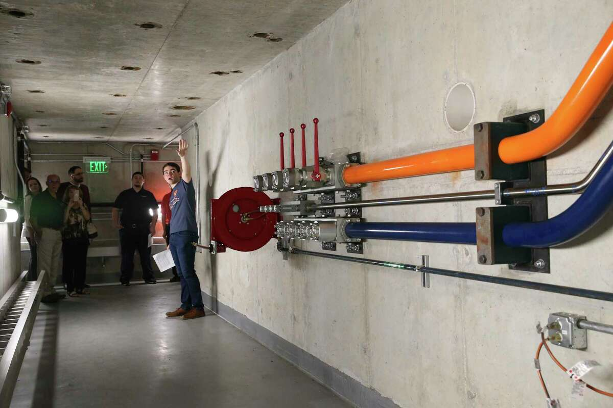 Daniel Vogel conducts a tour of the Large-Scale Testing Lab on Thursday. Vogel was leading a group through its basement. The University of Texas at San Antonio inaugurated the facility during a morning ceremony.