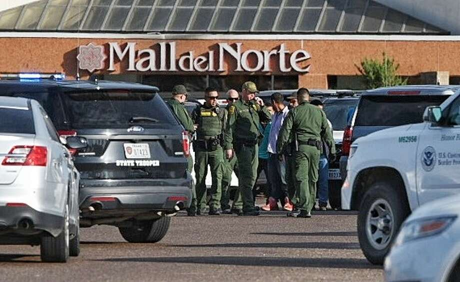 Border Patrol agents are seen apprehending a suspect after a vehicular chase. Photo: Danny Zaragoza/Laredo Morning Times