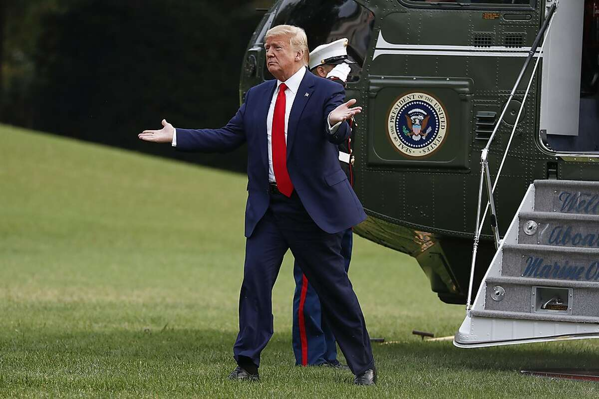 President Donald Trump extends his arms as he walks across the South Lawn of the White House in Washington, during his arrival on Marine One helicopter following a short trip from nearby Andrews Air Force Base, Md., Thursday, Oct. 3, 2019. (AP Photo/Pablo Martinez Monsivais)
