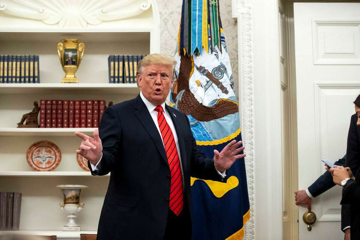 """President Donald Trump speaks to reporters in the Oval Office after the swearing-in of his new labor secretary, Eugene Scalia, on Monday, Sept. 30, 2019. Trumpon Tuesday kept his focus on an anonymous whistle-blower, asking why he was not """"entitled to interview"""" the person, a day after he said the White House was trying to find out the person's identity, despite institutional directives and confidentiality protections."""