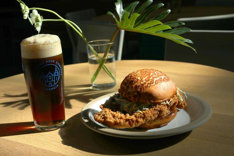 Pork Chop Bun & Black Pepper Sauce, Ginger Scallion Mayo, Cabbage & Onions paired with Westfalia beer seen on Tuesday, Oct. 1, 2019, in San Francisco, Calif.  Fort Point Beer Co., San Francisco's largest independent brewery, opens a 3,000-square-foot beer hall on Oct. 7. Photo: Liz Hafalia, The Chronicle