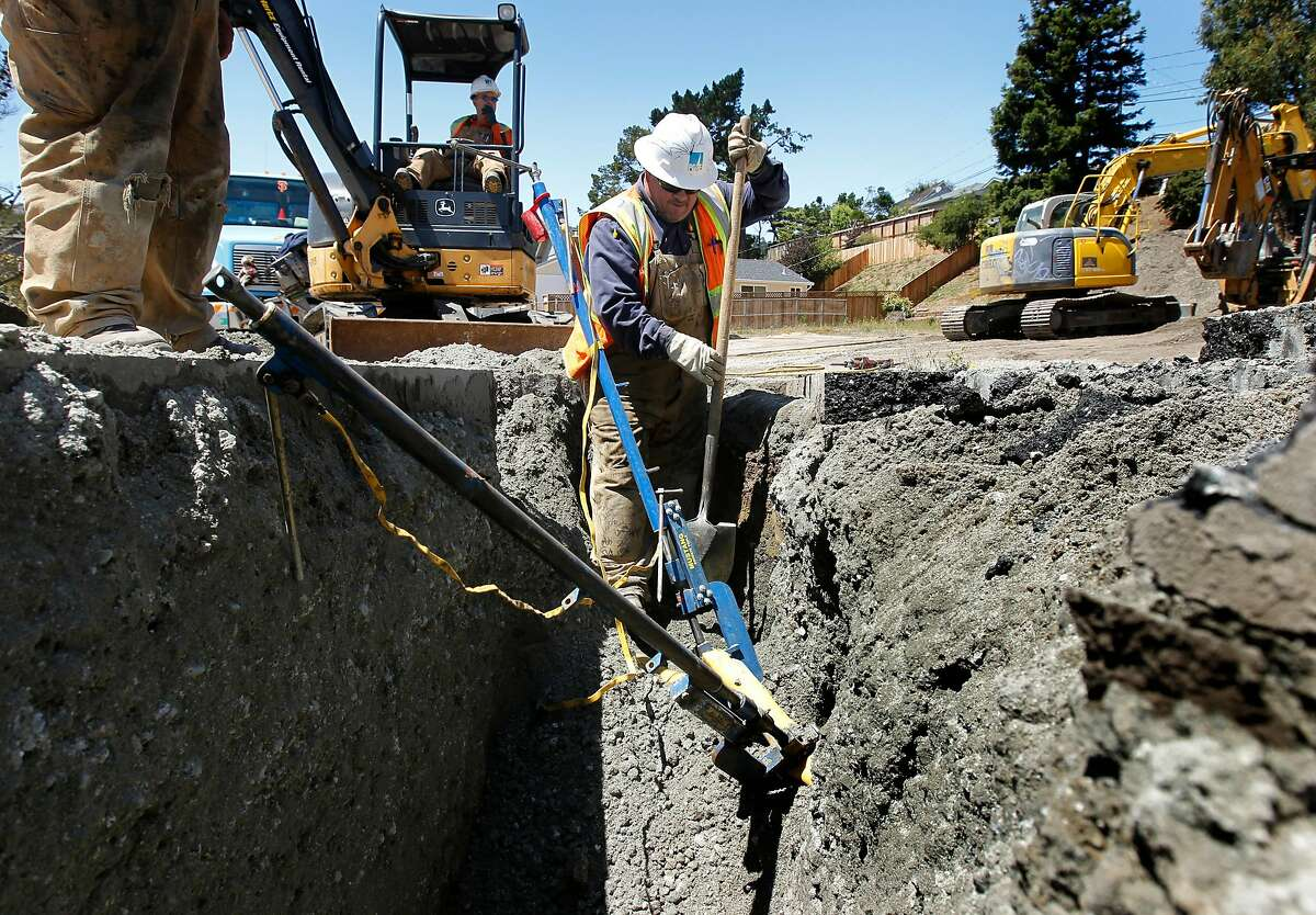 A PG&E crew replaces a two-inch gas line in San Bruno, Calif. on Thursday, Aug. 2, 2012 after it was punctured by an independent contractor digging at Earl Avenue and Glenview Drive, the exact location of the gas line explosion nearly two years ago.