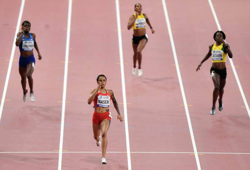 Salwa Eid Naser, of Bahrain, wins gold in the women's 400 meter final at the World Athletics Championships in Doha, Qatar, Thursday, Oct. 3, 2019. (AP Photo/Martin Meissner)