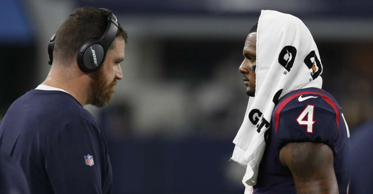 Houston Texans offensive coordinator Tim Kelly, left, talks to quarterback Deshaun Watson (4) during the second quarter of an NFL preseason football game against the Dallas Cowboys at AT&T Stadium on Saturday, Aug. 24, 2019, in Arlington, Texas.