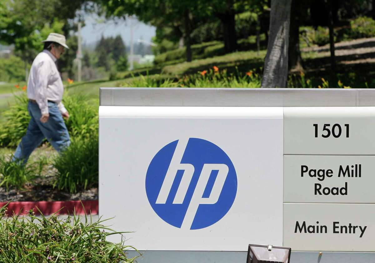 A Hewlett-Packard worker walk in the main entrance of HP Headquarters in Palo Alto, Calif., Thursday, May 17, 2012. >>See which companies were hiring in September in the photos that follow...