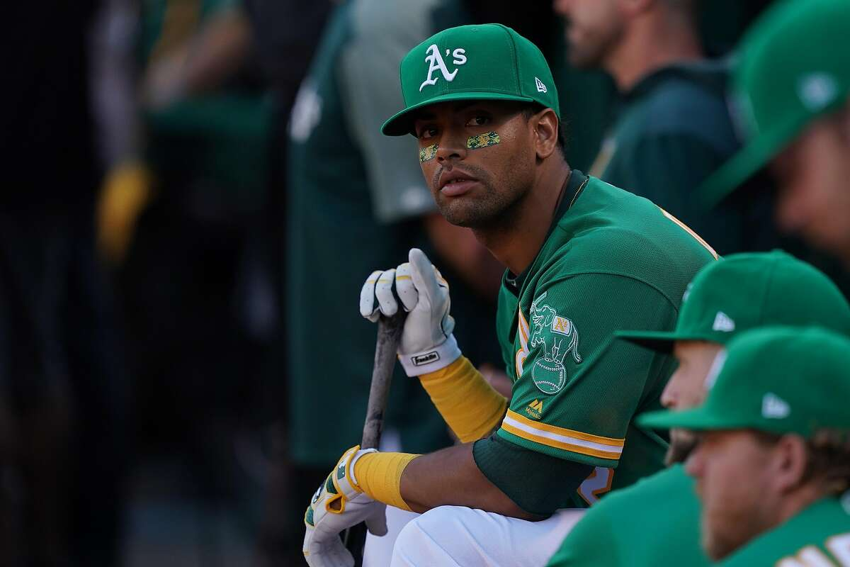 OAKLAND, CALIFORNIA - OCTOBER 02: Khris Davis #2 of the Oakland Athletics looks on from the dugout during the American League Wild Card Game against the Tampa Bay Rays at RingCentral Coliseum on October 02, 2019 in Oakland, California. (Photo by Thearon W. Henderson/Getty Images)