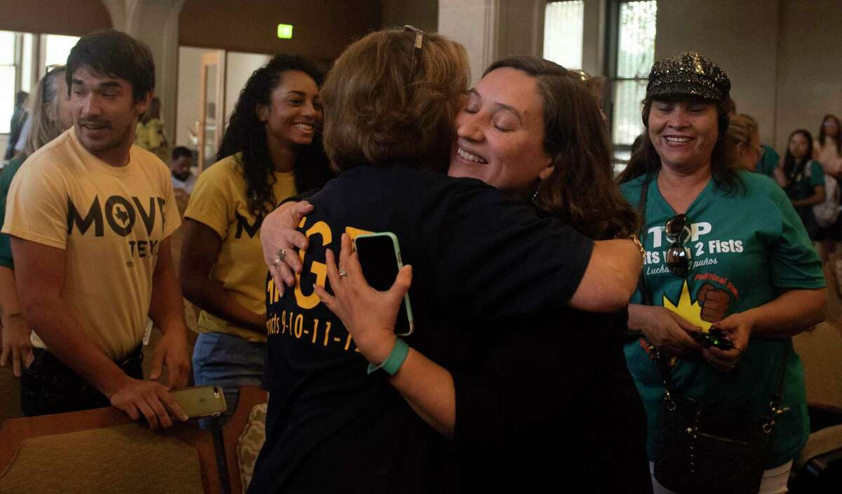 Texas Organizing Project Executive Director Michelle Tremillo celebrates with supporters after the San Antonio City Council voted 8-3 to pass the safe and sick leave ordinance on Thursday, Oct. 3, 2019.