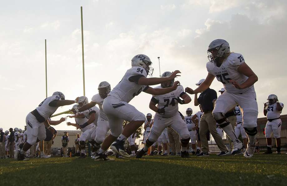 College Park linemen warm up before a District 15-6A high school football game against Klein Forest at Klein Memorial Stadium, Thursday, Oct. 3, 2019, in Spring. Photo: Jason Fochtman, Staff Photographer