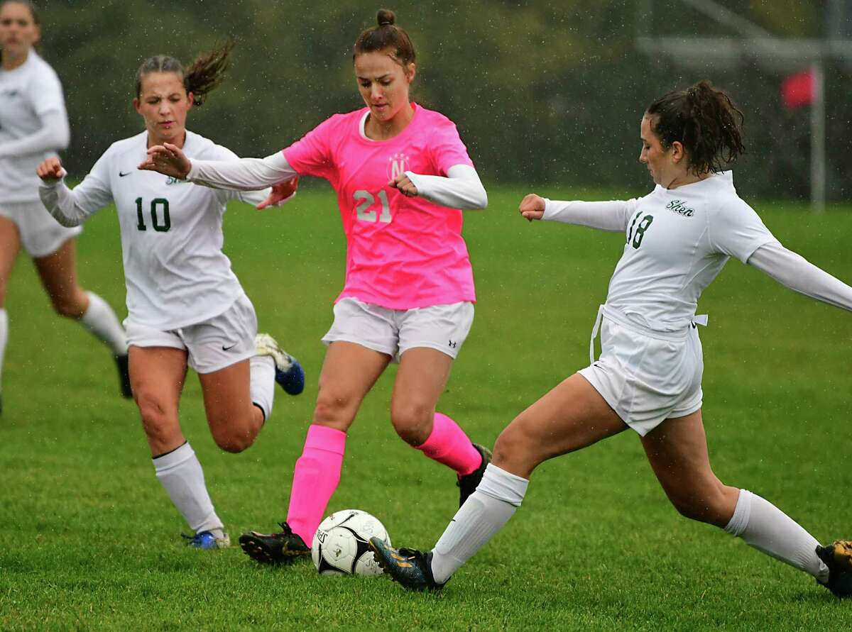 Niskayuna's Kelsey Barber, center, battles for the ball with Shenendehowa's Haylee Evertsen, left, and Gloria Kokkinides during a soccer game on Thursday, Oct. 3, 2019 in Niskayuna, N.Y. (Lori Van Buren/Times Union)
