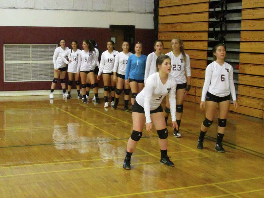 Torrington's vollleyball team lines up for drills before its win over Crosby Thursday night at Torrington High School. Photo: Peter Wallace / For Hearst Connecticut Media