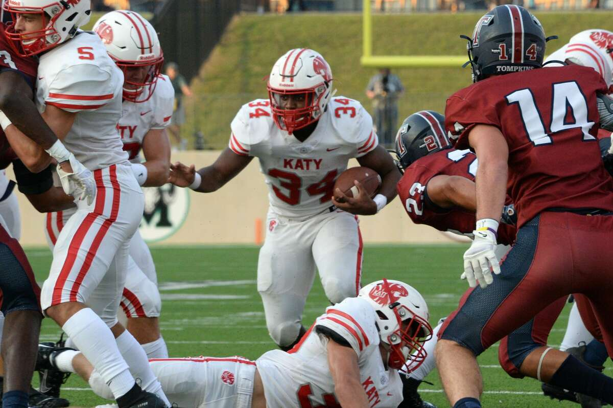 PHOTOS: Katy vs. Tompkins Ron Hoff (34) of Katy carries the ball during the first quarter of a 6A Region III District 19 football game between the Katy Tigers and the Tompkins Falcons on Thursday, October 3, 2019 at Legacy Stadium, Katy, TX.