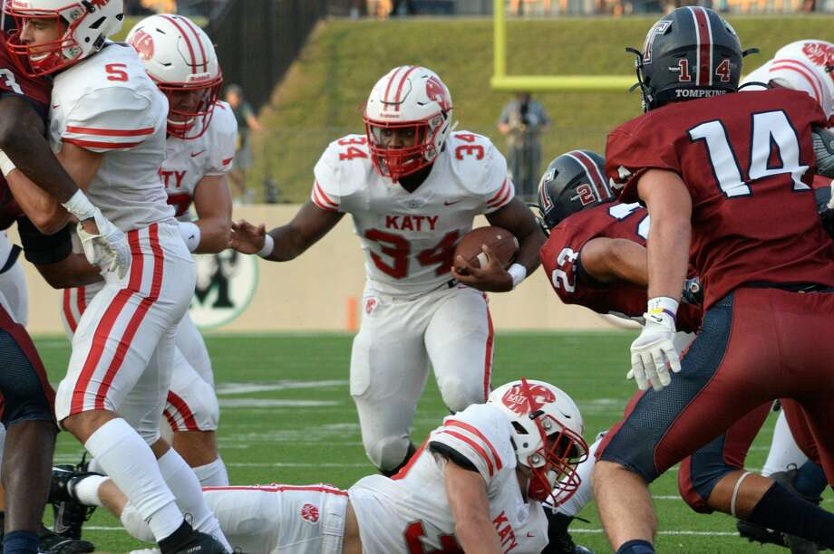 PHOTOS: Katy vs. Tompkins Ron Hoff (34) of Katy carries the ball during the first quarter of a 6A Region III District 19 football game between the Katy Tigers and the Tompkins Falcons on Thursday, October 3, 2019 at Legacy Stadium, Katy, TX. Photo: Craig Moseley/Staff Photographer