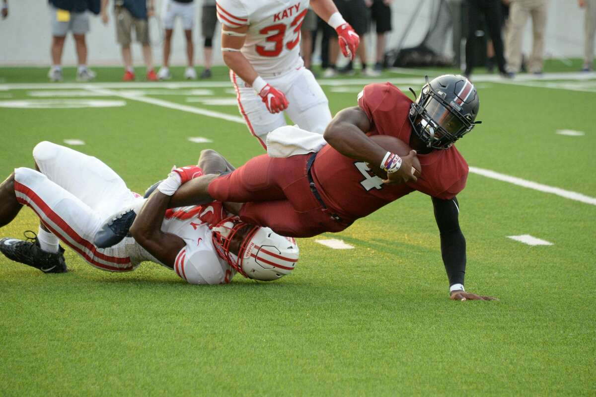 Jalen Milroe (4) of Tompkins is sacked by Jaylen Phillips (9) of Katy during the first quarter of a 6A Region III District 19 football game between the Katy Tigers and the Tompkins Falcons on Thursday, October 3, 2019 at Legacy Stadium, Katy, TX.