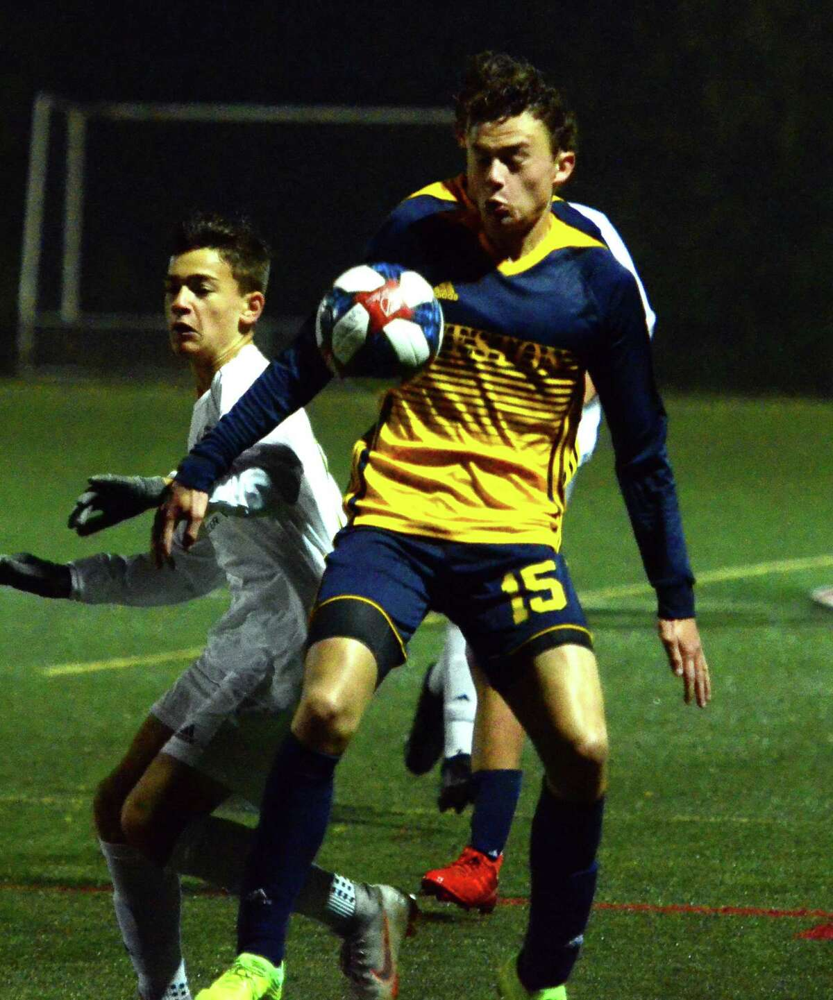 Weston's Daniel Bello deflects the ball during boys soccer action against Joel Barlow in Weston, Conn., on Thursday Oct. 3, 2019.