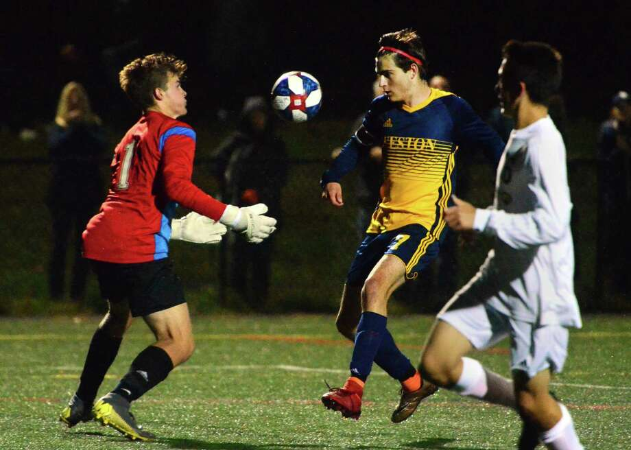 Joel Barlow goalie Will Stewart makes a save as Weston's Mason Asphar converges during boys soccer action in Weston, Conn., on Thursday Oct. 3, 2019. Photo: Christian Abraham / Hearst Connecticut Media / Connecticut Post