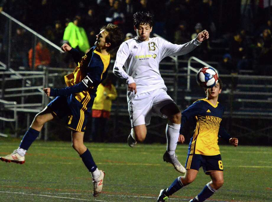 Weston's Jack Fellowes, left, and Joel Barlow's Julio Calish head the ball during boys soccer action in Weston, Conn., on Thursday Oct. 3, 2019. Photo: Christian Abraham / Hearst Connecticut Media / Connecticut Post