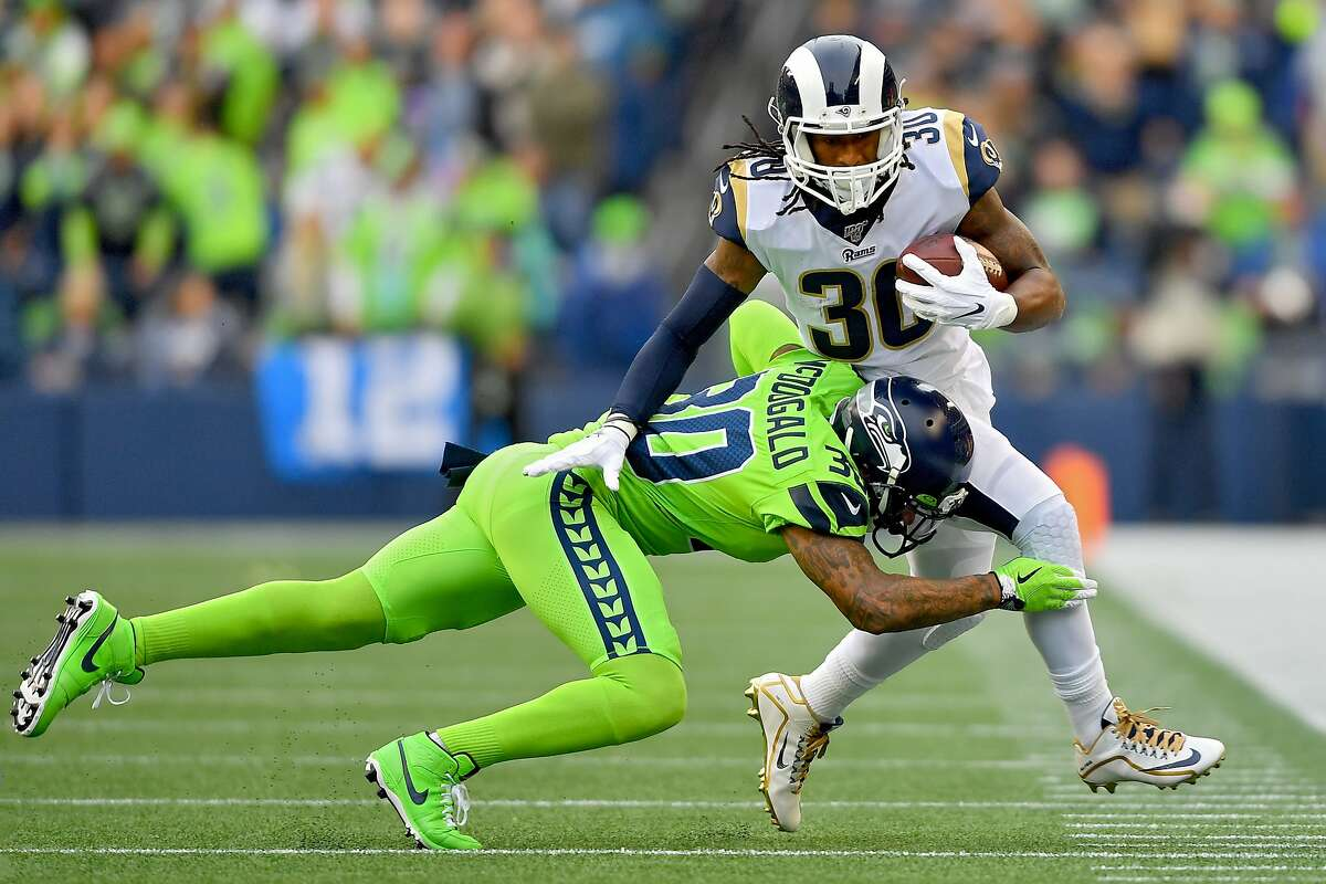 SEATTLE, WASHINGTON - OCTOBER 03: Todd Gurley #30 of the Los Angeles Rams runs the ball against Bradley McDougald #30 of the Seattle Seahawks during the first half of game at CenturyLink Field on October 03, 2019 in Seattle, Washington. (Photo by Alika Jenner/Getty Images)