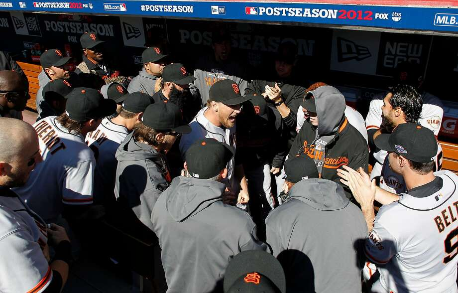 Giants outfielder Hunter Pence, center, rallies the team before the first pitch of Game 5 of the National League Division Series in Cincinnati on Oct. 11, 2012. Photo: Michael Macor / The Chronicle