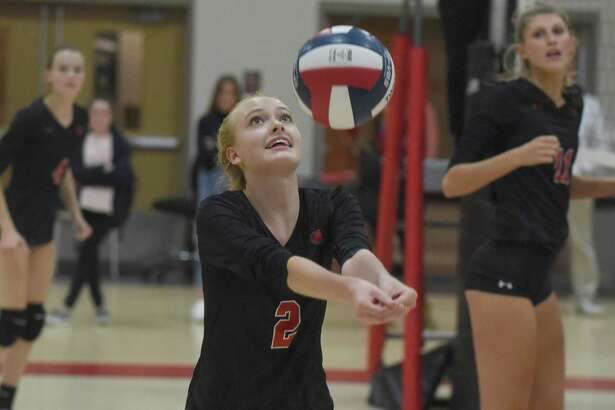 New Canaan's Elle Sneddon (2) hits a pass during a girls volleyball match against Trumbull in New Canaan on Thursday, Oct. 3, 2019.