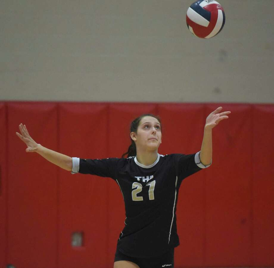 Trumbull's Ali Castro (27) serves during a girls volleyball match in New Canaan on Thursday, Oct. 3, 2019. Photo: Dave Stewart / Hearst Connecticut Media / Hearst Connecticut Media