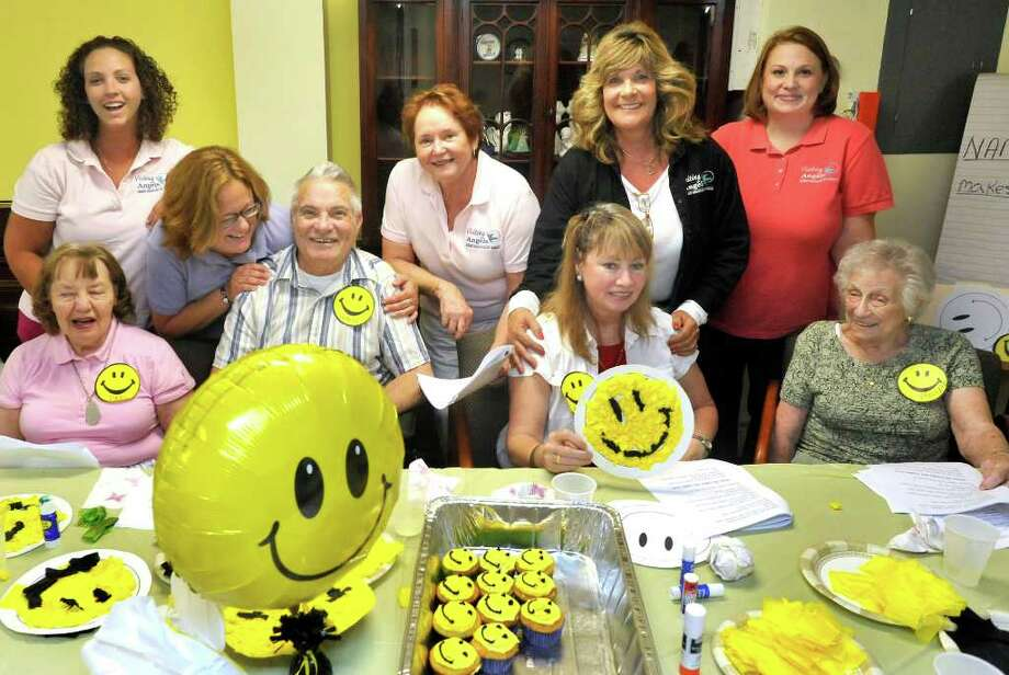 A Visiting Angels social program that gets seniors out of the house includes clients and caregivers making cupcakes in Brookfield, Thursday, August 5, 2010. Patricia Werlau, owner and director, is standing center. Photo: Michael Duffy / The News-Times