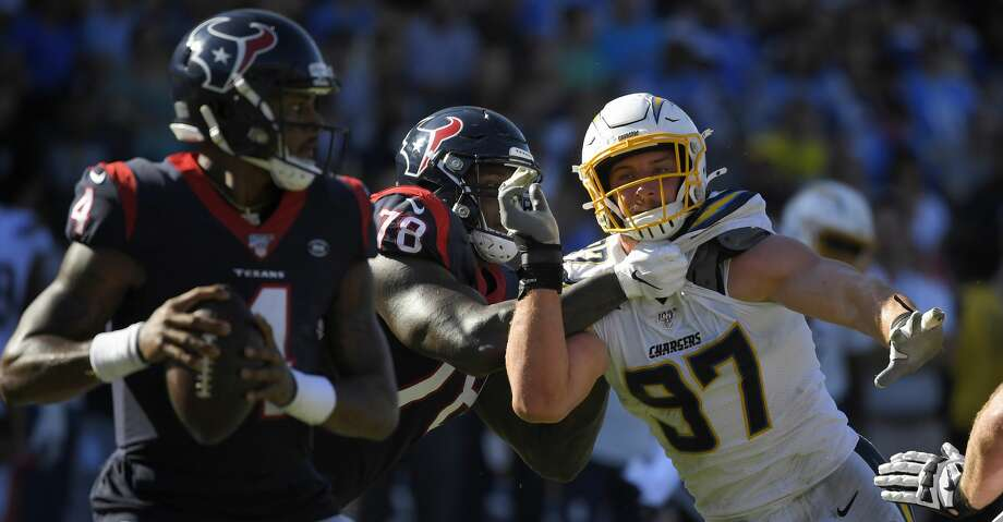 Los Angeles Chargers defensive end Joey Bosa, right, tries to get past Houston Texans offensive tackle Laremy Tunsil, center, to get to quarterback Deshaun Watson during the second half of an NFL football game Sunday, Sept. 22, 2019, in Carson, Calif. (AP Photo/Mark J. Terrill) Photo: Mark J. Terrill/Associated Press