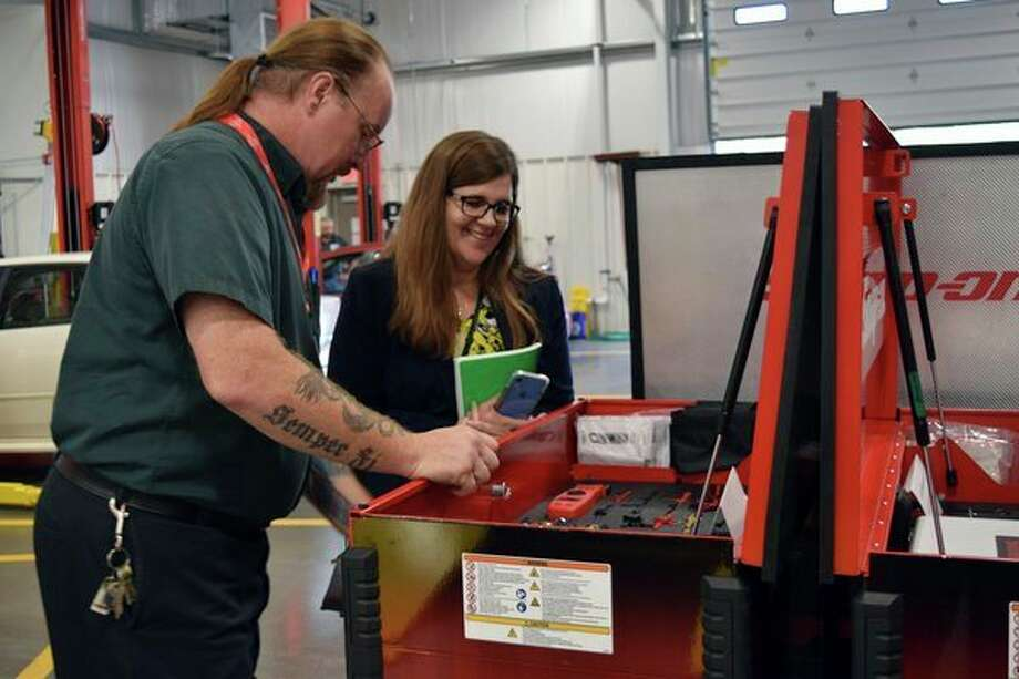 CTE Auto Tech Instructor Don Maurer shows off some new Snap-On equipment to Jennifer Geno, Saginaw's CTE director. (Photo provided)