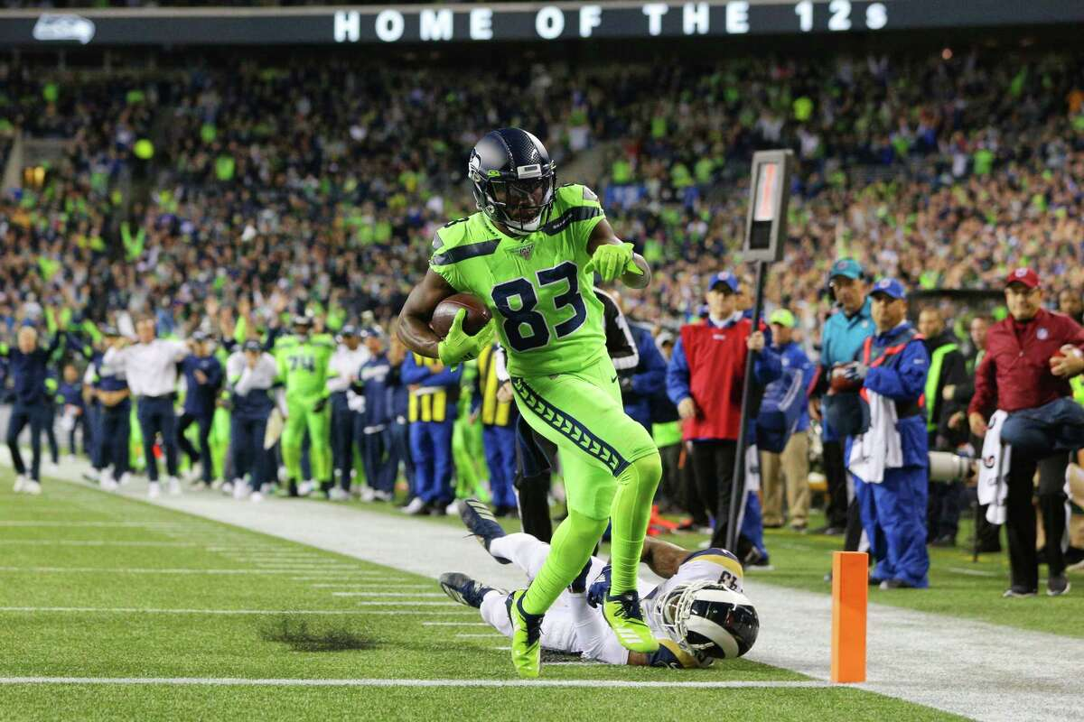 Seattle Seahawks wide receiver David Moore (83) runs in a touchdown in the third quarter of Seattle's game against the LA Rams, Thursday, Oct. 3, 2019.
