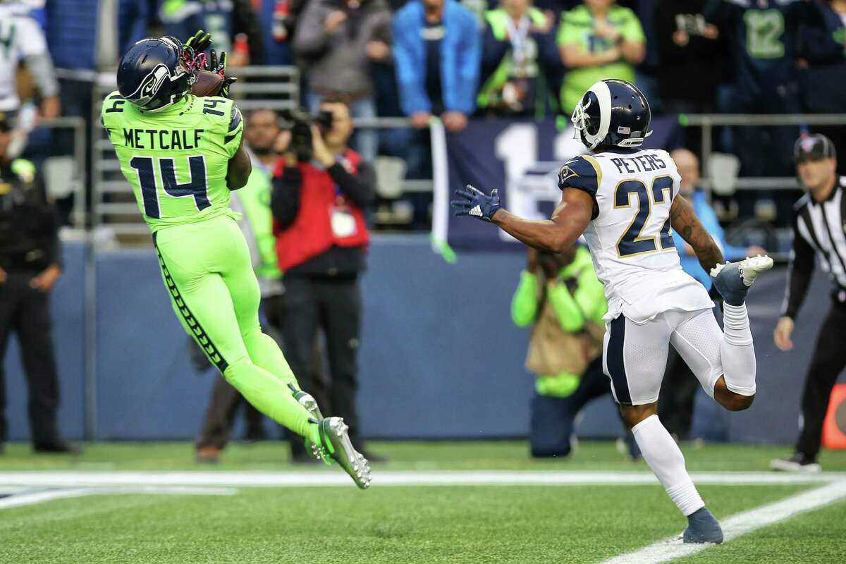 Seattle Seahawks wide receiver D.K. Metcalf (14) pulls in a 40 yard pass to score a touchdown in the second quarter of Seattle's game against the LA Rams, Thursday, Oct. 3, 2019.