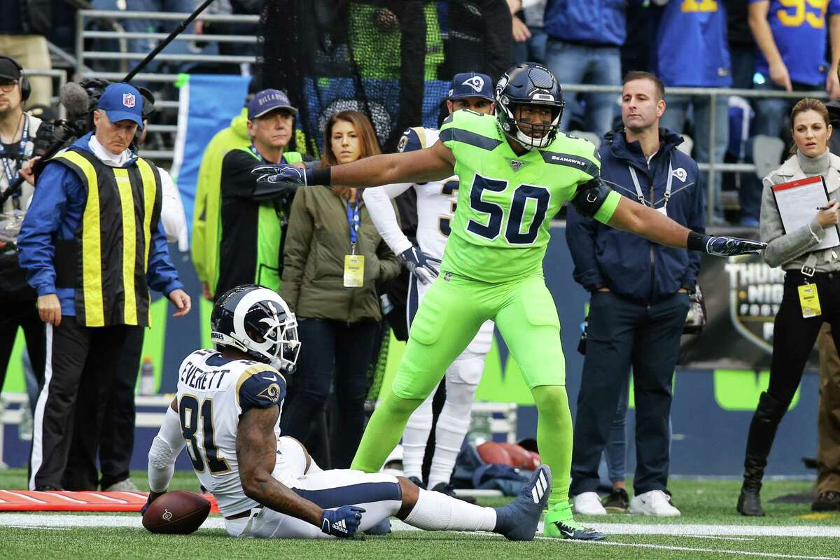 Seattle Seahawks outside linebacker K.J. Wright (50) signals an incomplete pass to Los Angeles Rams tight end Gerald Everett (81) during the first quarter of Seattle's game against the LA Rams, Thursday, Oct. 3, 2019.