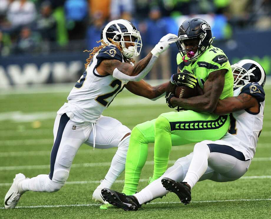Rams defenders take down Seattle Seahawks wide receiver D.K. Metcalf (14) during Seattle's game against the LA Rams, Thursday, Oct. 3, 2019. Photo: Genna Martin, Seattlepi.com / GENNA MARTIN