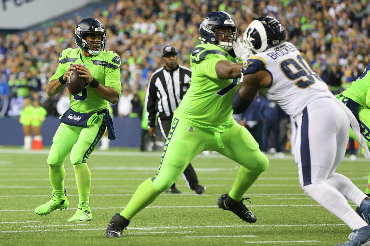 Seattle Seahawks quarterback Russell Wilson (3) looks to throw in the fourth quarter of Seattle's game against the LA Rams, Thursday, Oct. 3, 2019.