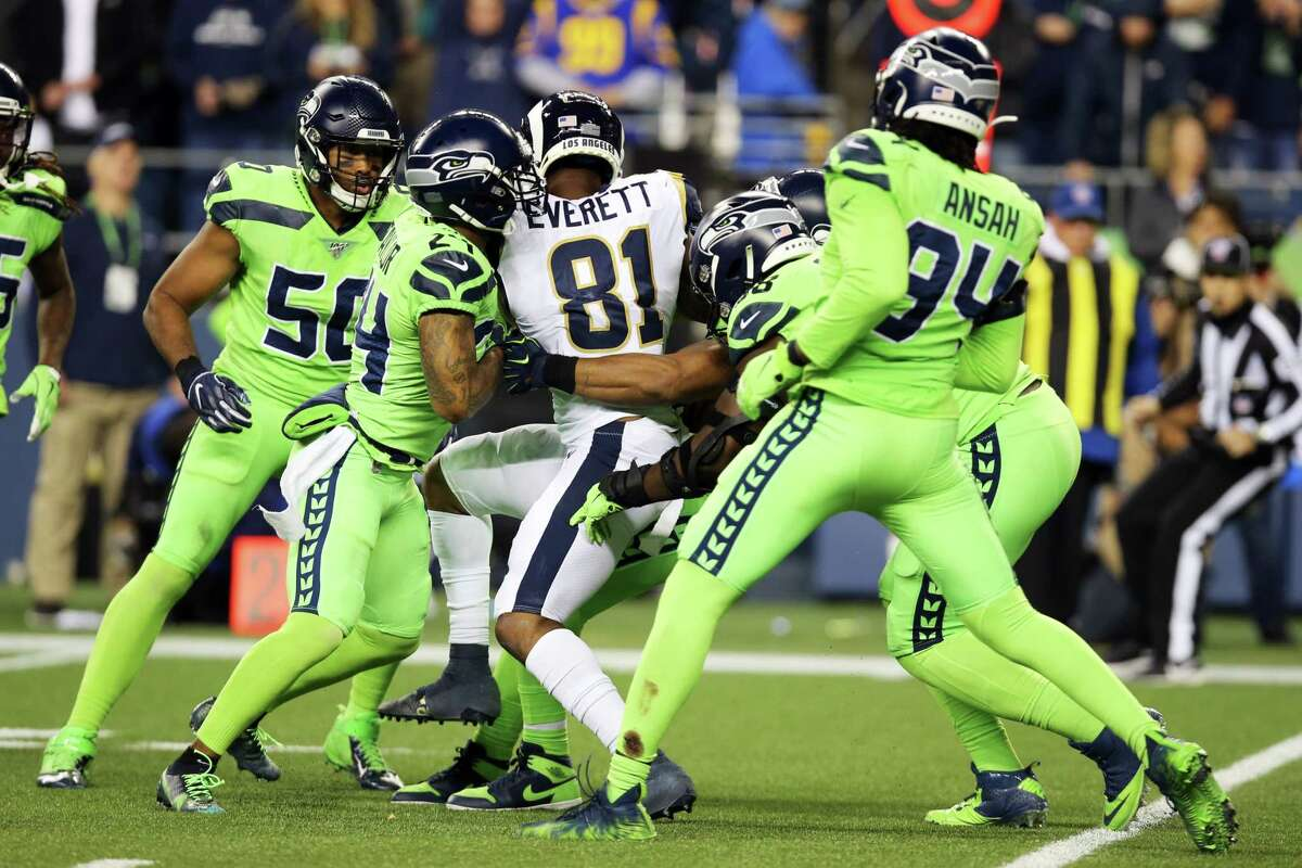 The Seahawks defense brings down Los Angeles Rams tight end Gerald Everett (81) in the fourth quarter of Seattle's game against the LA Rams, Thursday, Oct. 3, 2019.