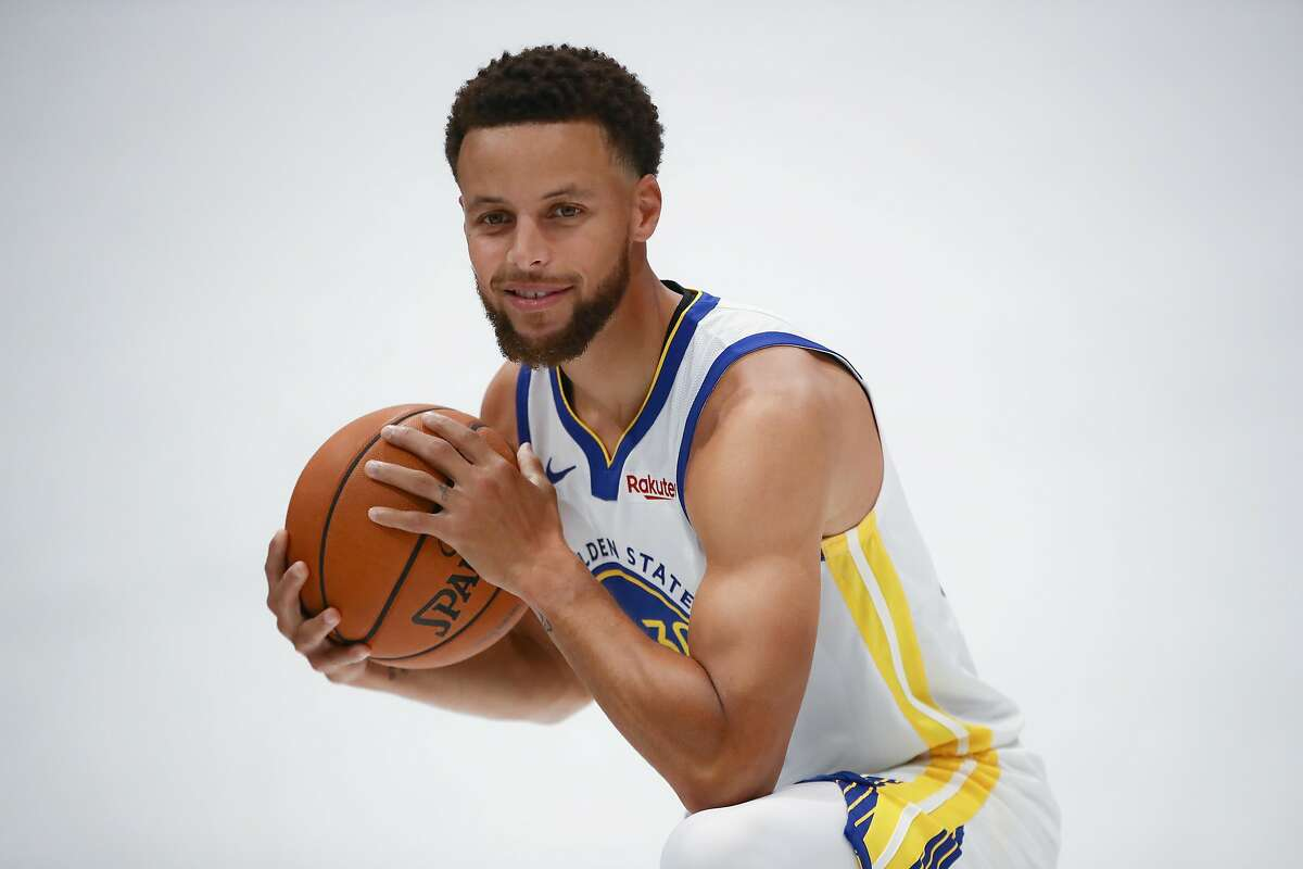 Stephen Curry poses for a picture during the Golden State Warriors media day at Chase Center on September 30, 2019 in San Francisco.